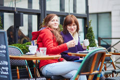 Two girls in Parisian street cafe Stock Photo