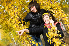 Two girls in the park look and point at something Royalty Free Stock Images