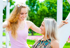 Two girls in the park Royalty Free Stock Photo