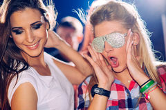 Two girls on party. People behind them Royalty Free Stock Photos