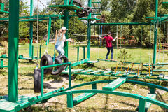 Two girls pass an outdoor obstacle course Royalty Free Stock Photography