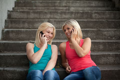 Two girls with the phones Royalty Free Stock Photography