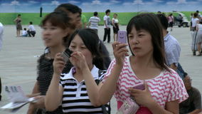 Two girls photographed on street city of Tiananmen Square. Beijing, China - 12 August 2015: Two girls photographed on street city of Tiananmen Square stock footage