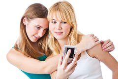 Two girls photographing on camera Royalty Free Stock Photography