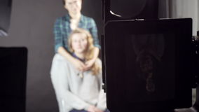 Two girls at photosession. Two young girls at photosession on a retro camera stock video