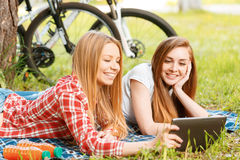 Two girls on a picnic with bikes Stock Photo