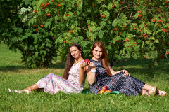 Two girls at picnic Stock Photos