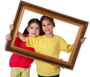 Two girls with a picture frame Royalty Free Stock Photo