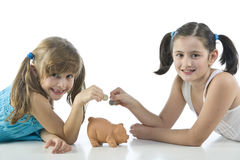 Two girls and piggy bank Stock Photo