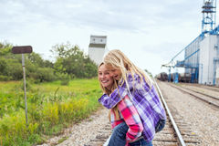 Two girls piggyback railroad track Stock Image