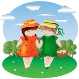 Two girls with pigtails in colored dresses and hats hold hands in a dotted with flowers, behind a forest and sky Royalty Free Stock Photo