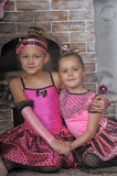 Two girls in pink for Christmas Royalty Free Stock Images