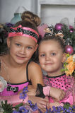 Two girls in pink for Christmas Stock Images