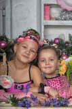 Two girls in pink for Christmas Stock Photo