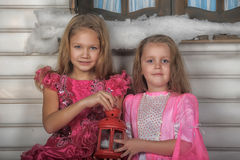 Two girls in pink for Christmas. Two girls sisters in pink in Christmas stock photo