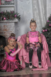 Two girls in pink for Christmas Stock Photos