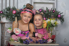 Two girls in pink for Christmas Stock Image