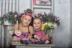 Two girls in pink for Christmas Royalty Free Stock Image
