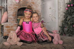 Two girls in pink for Christmas Royalty Free Stock Photos