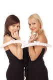 Two girls with pink hangers Royalty Free Stock Photos