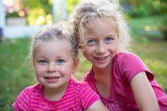 Two girls in pink Royalty Free Stock Photo