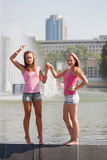 Two girls in pink vests Royalty Free Stock Photography