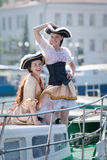 Two girls in pirate costumes on the boat Stock Image