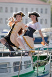 Two girls in pirate costumes on the boat Royalty Free Stock Photo