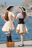 Two girls in pirate costumes outdoors. Two young woman in pirate costumes outdoors Royalty Free Stock Photos