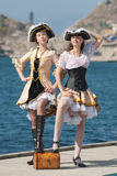 Two girls in pirate costumes outdoors. Two girls in pirate costumes on the pier Stock Photos