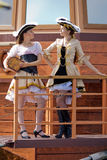 Two girls in pirate costumes outdoors Stock Images