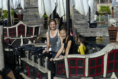 Two girls on pirate ship Stock Photos