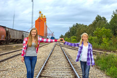 Two girls plaid shirts grain terminal Stock Photos