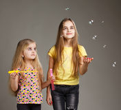 Two girls play bubble Royalty Free Stock Photo
