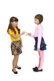 Two girls play roshambo Royalty Free Stock Photos