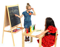 Two girls play in school (series) Stock Images