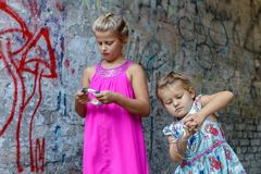 Two girls play stock photo