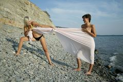 Two girls play witn fabric Royalty Free Stock Photo