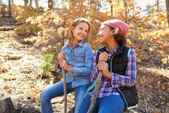 Two Girls Playing In Autumn Woods Together Stock Photos