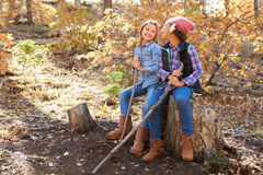 Two Girls Playing In Autumn Woods Together Stock Photography