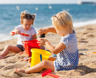 Two girls playing on  beach Stock Images