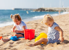 Two  girls playing on  beach Royalty Free Stock Photography