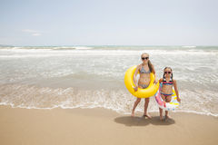 Two girls playing on the beach. Two girls having fun on a beautiful beach in the summertime Royalty Free Stock Image