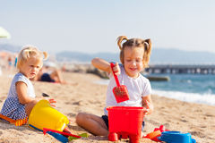 Two girls playing on  beach Royalty Free Stock Photos