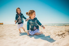 Two girls playing on the beach Royalty Free Stock Photography