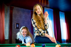 Two girls playing billiard Royalty Free Stock Photos