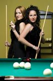 Two girls are playing billiards Royalty Free Stock Photos