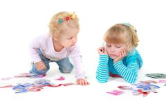 Two girls playing with colorful letters Stock Image