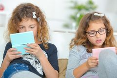 Free Two Girls Playing Computer Games Stock Image - 118385851
