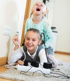Two girls playing with electricity Stock Photos